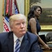 FILE - In this March 12, 2017 file photo, White House Director of communications for the Office of Public Liaison Omarosa Manigault, right, walks past