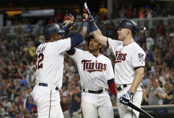 Miguel Sano, left, celebrates his two-run home run with Jorge Polanco, center, and Max Kepler in the eighth inning Tuesday.