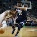 Boston Celtics' Kyrie Irving (11) drives past Minnesota Timberwolves' Jimmy Butler (23) during the second quarter of an NBA basketball in Boston, Frid