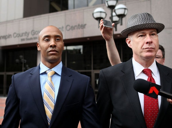 Former Minneapolis police officer Mohamed Noor, left, and attorney Thomas Plunkett in May.