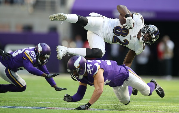 Baltimore Ravens tight end Benjamin Watson (82) is upended by Minnesota Vikings strong safety Andrew Sendejo (34). Sendejo has been suspended for one