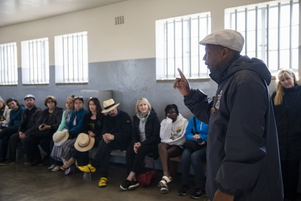 Tour guide and former political prisoner Derrick Basson leads a tour of the former prison on Robben Island.