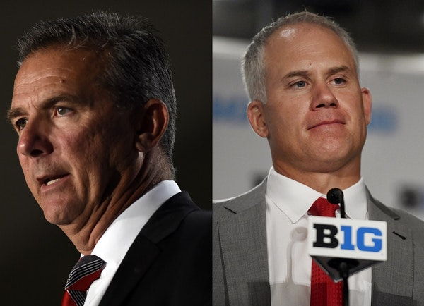 Ohio State coach Urban Meyer, left, is on administative leave with the Buckeyes' opener on Sept. 1. Maryland coach DJ Durkin, also on administrative