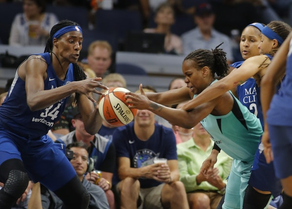 Sylvia Fowles (34) and Kia Nurse(5) fight for the ball during a game between the Lynx and New York earlier this season. .