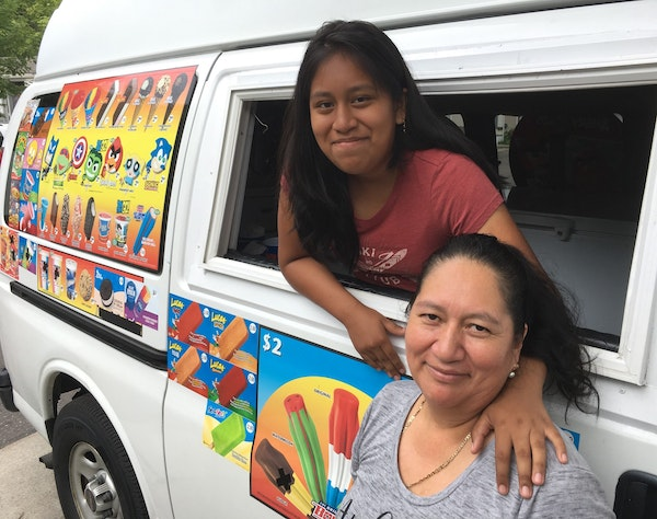 Gina, left, and her mom, Rosa Chunchi, with their cold-treat truck that was vandalized by a stranger at a Minneapolis park.