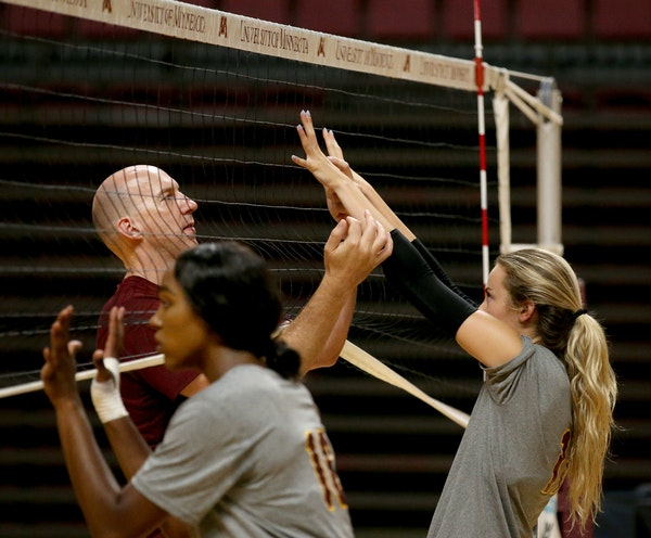 Gophers volleyball coach Hugh McCutcheon worked with senior setter Samantha Seliger-Swenson during practice Tuesday at Maturi Pavilion.