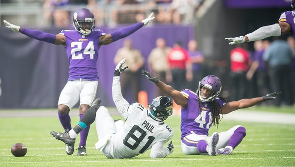 There were no penalties involved on this play when Vikings safety Anthony Harris, right, and cornerback Horace Richardson broke up a pass intended for
