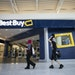Jackie Nierenhausen and Cong Nguyen (holding his daughter Alaina Nguyen, 2, on his shoulders) walked past Best Buy at the Mall of America on Friday. B