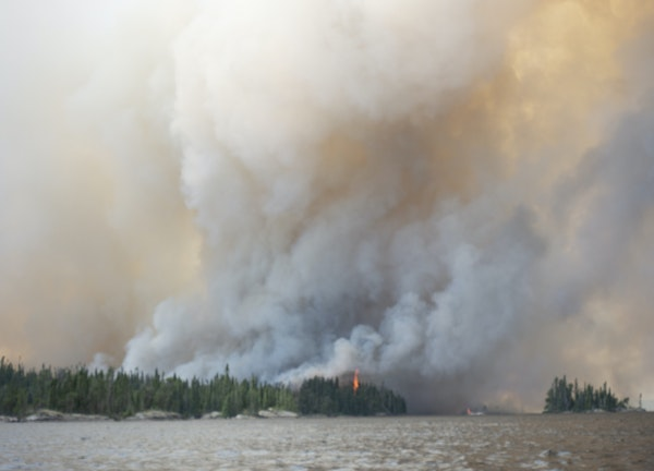 Canoeist Pete Arnesen of the Twin Cities capured this shot of Canadian forest fires from a distance, but they got close enough to him to prompt him to