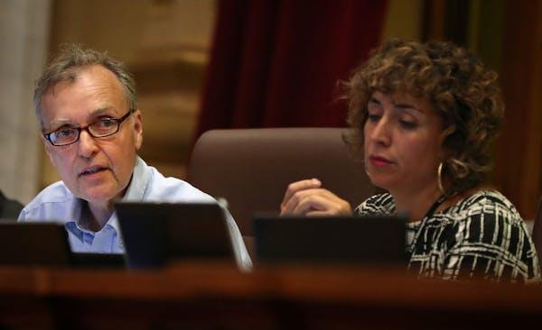 Minneapolis City Council Member Cam Gordon discussed his amendment proposal last month as Council Member Alondra Cano listened.