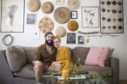 Johnna and Max Holmgren pose for a photo in their living room.