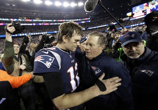 New England Patriots quarterback Tom Brady, left, hugs coach Bill Belichick after the AFC championship NFL football game against the Jacksonville Jagu