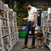 Garrett Fitzgerald browsed the DVDs for sale along with his housemate's dog Hondo at The Movies on 35th Street.