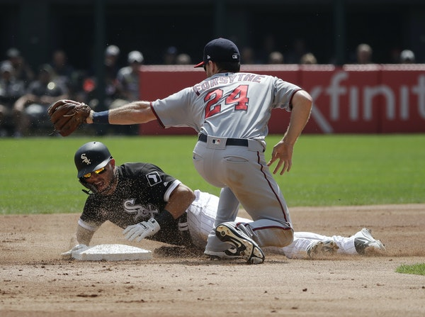 Yolmer Sanchez of the White Sox was tagged out by Logan Forsythe of the Twins on an attempted steal Wednesday.