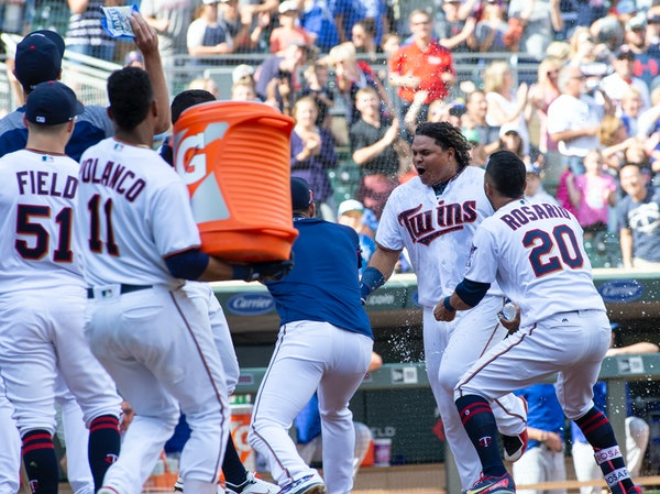 Willians Astudillo, second right, is mobbed by teammates after hitting a 2-run home run in the ninth inning