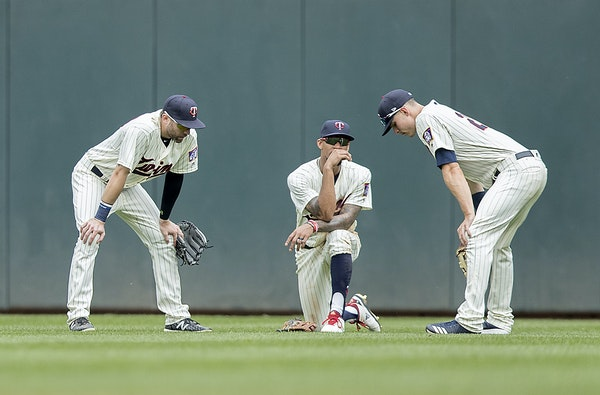Twins outfielders Jake Cave, Byron Buxton and Max Kepler conferred during a pitching change in a May game at Target Field.