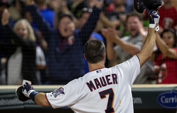 Minnesota Twins Joe Mauer came out for a curtain call after hitting a grand slam home run in the fifth inning.