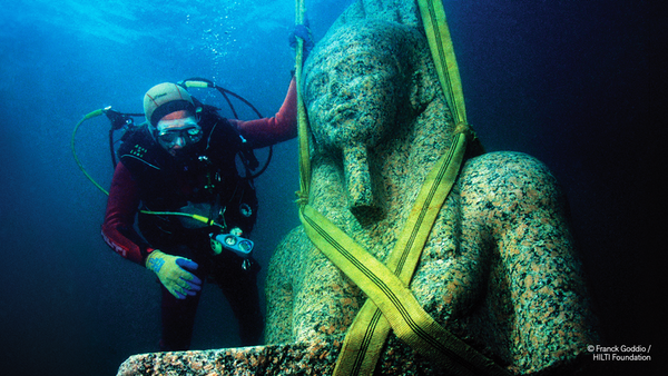 The bust of the colossal statue of Hapy, which weighs in at 9,700 pounds, before being cautiously raised out of the water of Aboukir bay, Egypt. It wi