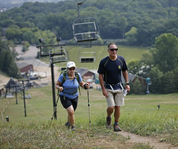 Marsha McDonald and Patrick Hinch climbed Mount Gilboa in Bloomington. She's training for the Superior Hiking Trail; he's headed to Machu Picchu.