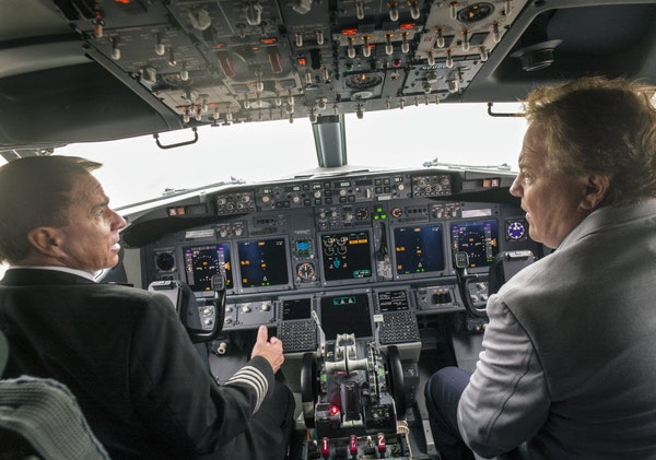 Former Sun Country owner Marty Davis, right, and Capt. Brian Roseen checked out a new Boeing 737 in 2015.