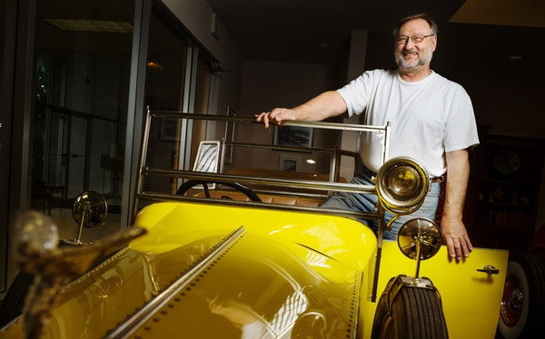 """Linus Vlatkovich with one of his favorite props, a 1925 Rolls-Royce created for the Guthrie's 2006 staging of """"The Great Gatsby."""""""