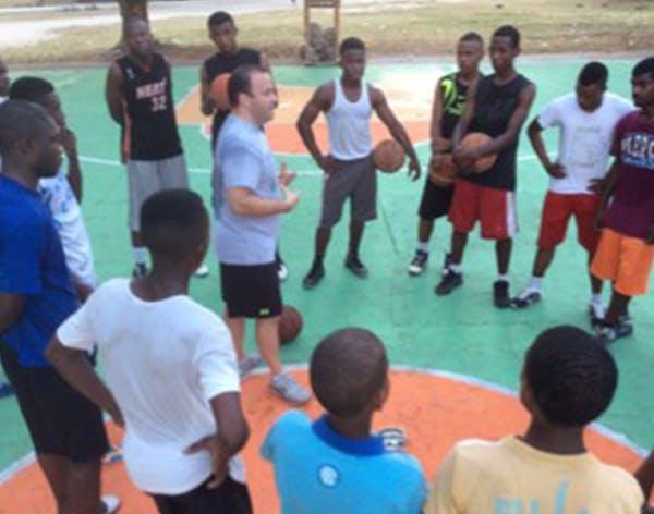 Matt McCollister, left photo, conducted a clinic in Zanzibar, an island off the coast of Tanzania. A young Tanzanian held a makeshift basketball. The