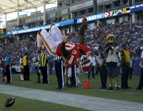 AP Photo/Jae C. Hong Kansas City Chiefs wide receiver Tyreek Hill celebrates after scoring during the second half of a game against the Los Angeles Ch
