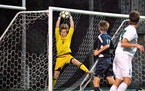 Breck goalkeeper Hudson Haecker makes a leaping save.
