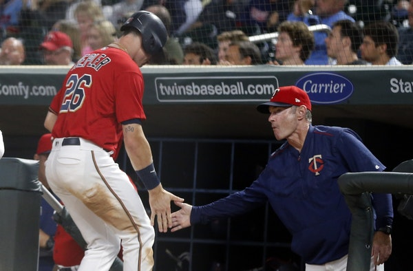 Minnesota Twins manager Paul Molitor, right, congratulates Max Kepler, who scored oon a single by Ehire Adrianza on Friday night.