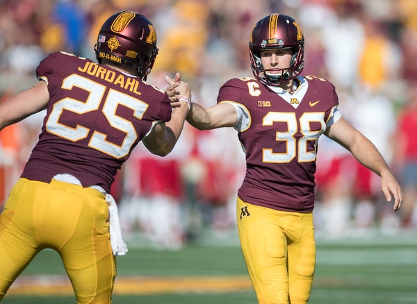 Gophers kicker Emmit Carpenter, who celebrated after a field goal with teammate Payton Jordahl last week, is the most accurate in team history.
