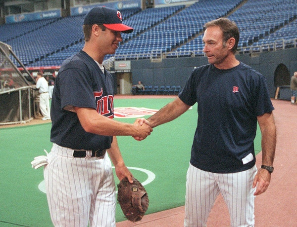 Joe Mauer and Paul Molitor - both Cretin-Derham Hall graduates - exchanged pleasantries in 2001 after Mauer was drafted by the Twins. Now Molitor is o