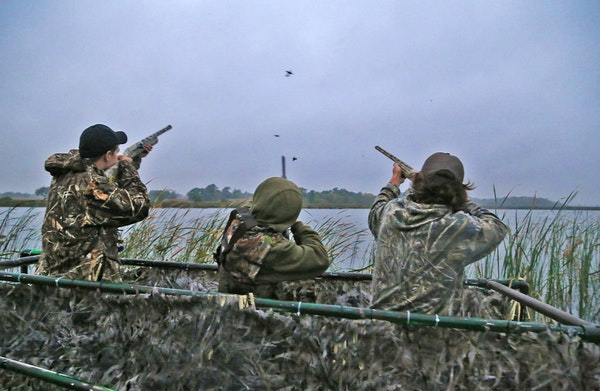 Trevor Unruh, left, Riley Mcalpine and Ryder Beckman drew down on a few blue-winged teal at the opener of the 2016 Minnesota duck season. The three we