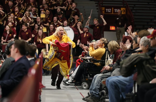 """Gophers fan Elvira """"Peps"""" Neuman of Clearwater cheered at Williams Arena last February. Lindsay Whalen's coaching debut Nov. 9 at the Barn is near"""