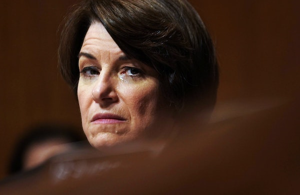 Sen. Amy Klobuchar (D-Minn.) fights back tears as the Senate Judiciary Committee prepares to vote on the nomination of Judge Brett Kavanaugh to the Su