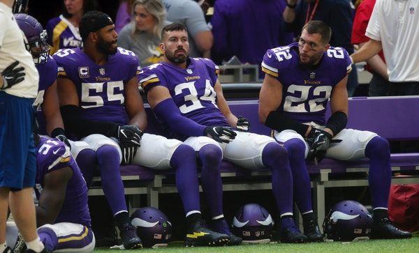 Vikings players Anthony Barr, from left, Andrew Sendejo and Harrison Smith sat on the bench aft the end of Sunday's loss to the Bills.