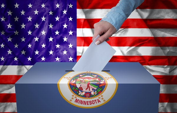 iStock A hand casting a vote in a ballot box for an election in Minesota, USA.