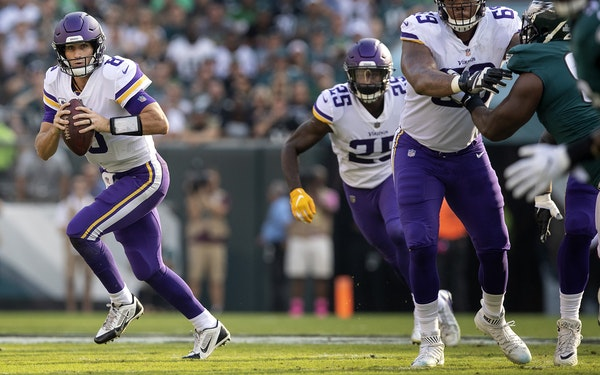 Minnesota Vikings quarterback Kirk Cousins looked for a target in Sunday's game against the Eagles.