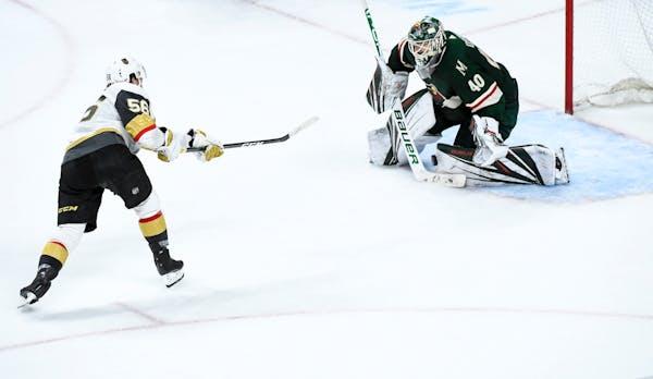 Vegas' Erik Haula scores the game-winning goal against the Wild's Devan Dubnyk during a shootout on Saturday