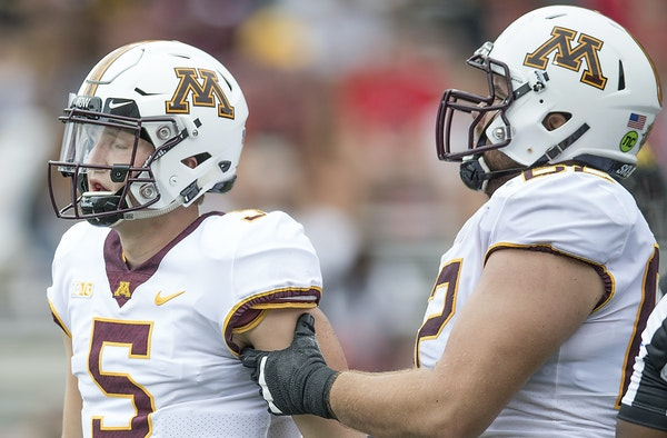 Gophers quarterback Zack Annexstad, left, struggled in his first Big Ten road start, going 14-for-32 for 169 yards, a TD and two picks.
