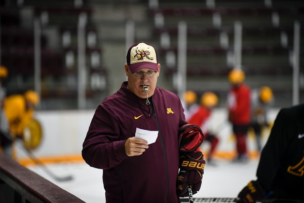 New Gophers men's hockey coach Bob Motzko looked through some notes during a recent practice at Ridder Arena.