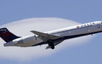 A Delta Air Lines passenger jet plane, a Boeing 717-200 model, approaches Logan Airport in Boston, Thursday, May 24, 2018. (AP Photo/Charles Krupa)