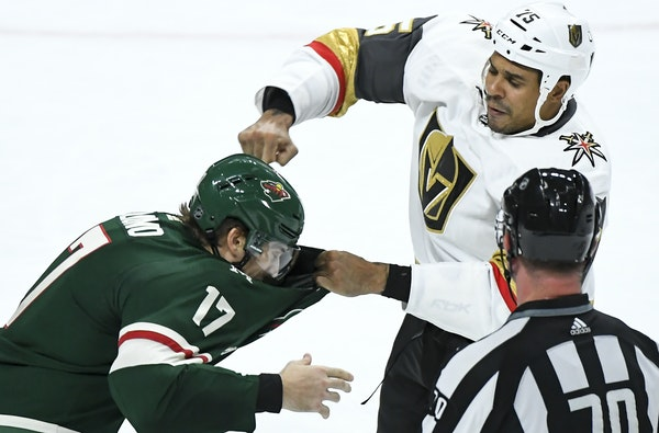Wild winger Marcus Foligno (17) dropped the gloves with Vegas tough guy Ryan Reaves (75) on Saturday night.