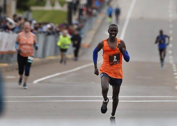 Elisha Barno (bib No. 2), from Kenya, won the Twin Cities Marathon with a time of 2:11:58.