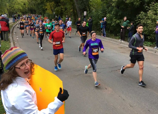 Runners on Lake Harriet Parkway on Sunday morning during the Twin Cities Marathon.