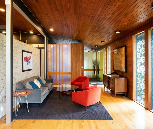 Aluminum panels framed with wood highlight the interior.