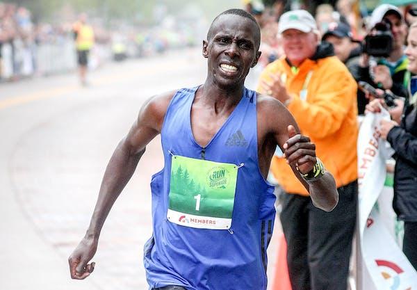 Elisha Barno of Santa Fe, NM. crosses the finish line of Grandma's Marathon in Canal Park