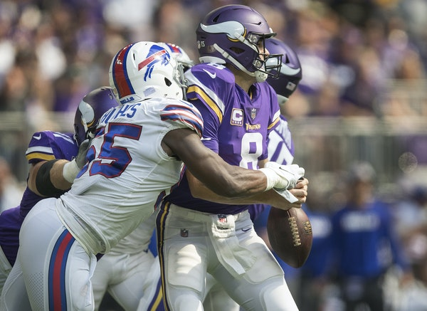 Vikings quarterback Kirk Cousins fumbled after a hit by Bills defensive end Jerry Hughes (55) on Sunday.