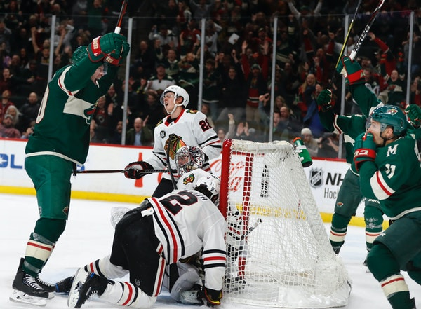 The Wild celebrates a last-minute goal in regulation tie the game up and send it overtime.