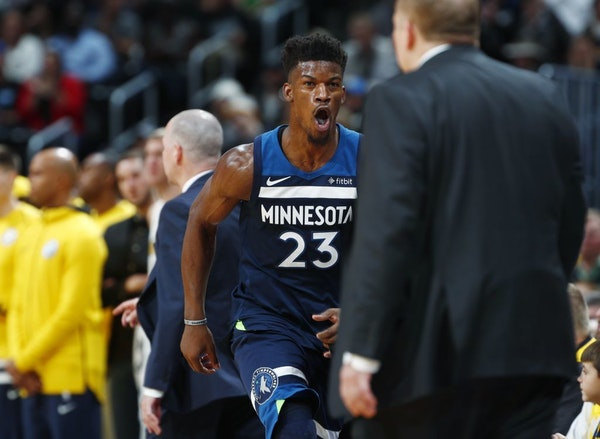 Timberwolves guard Jimmy Butler (23) runs back to the bench and head coach Tom Thibodeau during a game in December.