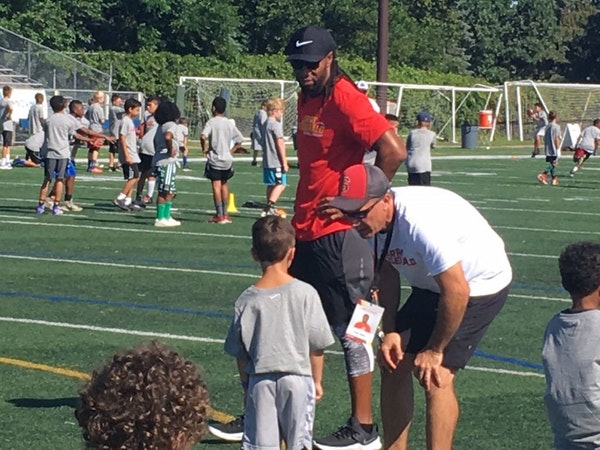 Larry Fitzgerald looked on during a football camp he sponsored this summer at Academy of Holy Angels in Richfield.